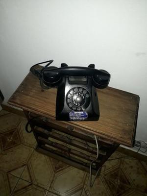 Vendo teléfono antiguo funcionando en perfecto estado.