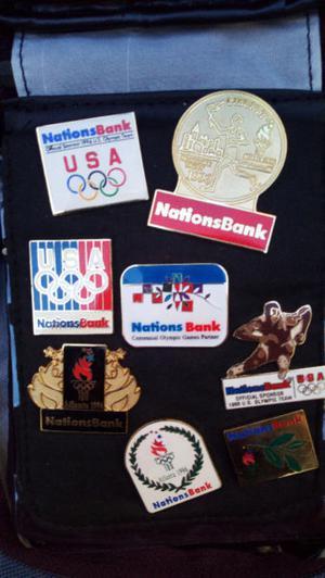 colección de pins y moneda olimpicos