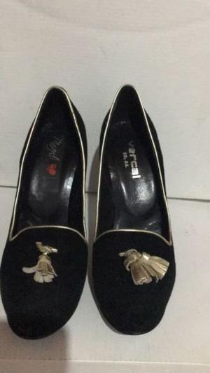 Vendo zapatos negros altos de fiesta