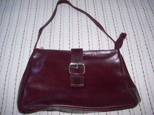 Vendo Cartera de cuero color bordo