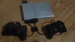Playstation 2 con 2 joysticks y juegos