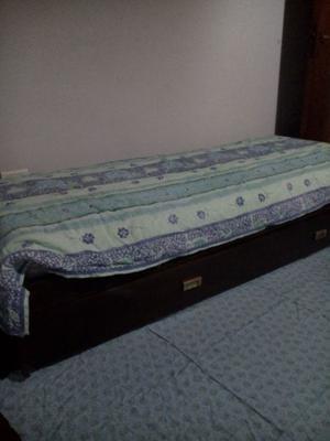 cama de una plaza con carrito cama
