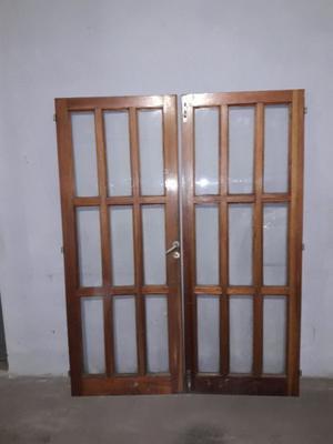 Vendo puerta de madera 2 hojas cedro vidrio repartido