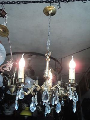 Antigua araña bronce macizo y caireles. Antigua Saudade