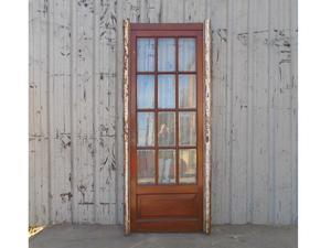 Antigua puerta de madera en cedro a vidrios biselados