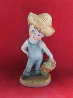 Figura en porcelana – Niño jardinero
