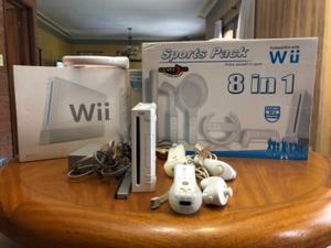 Consola con juegos y accesorios