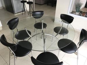 Vendo mesa redonda de vidrio y 6 sillas