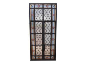 Antigua ventana de hierro tipo mampara con vitraux