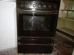 Vendo cocina LONGVIE COLOR marrón. Con encendido electrico.