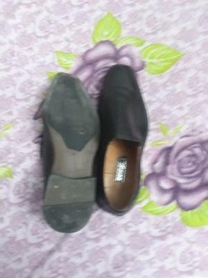1 par de Zapatos