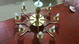 Araña de hierro forjado en dorado