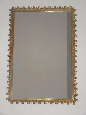 repisa de bronce con marmol y espejo con borde de bronce
