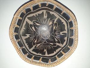 Centro de mesa cerámica y mimbre $500
