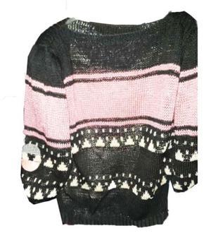 blusa tejida en hilo de seda con apliques en cuero