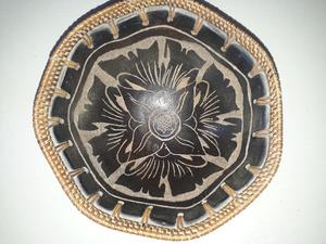 Centro de mesa cerámica y mimbre $400