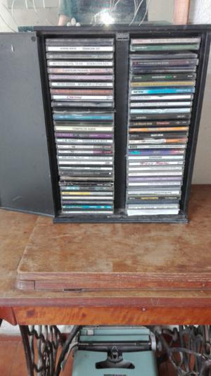 65 cd variados en su caja porta cd