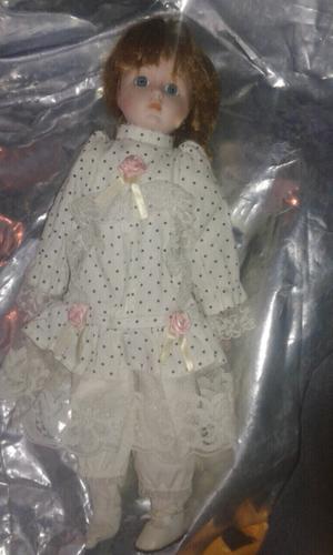 Muñeca de porcelana de coleccion vendo