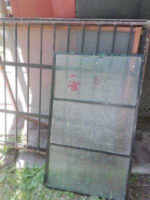 ventana de hierro con reja $1500