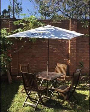 Juego de jardin top mesa y 4 sillones plegables.madera