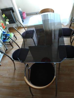 Juego de Mesa de Vidrio y 6 sillas 2 tipo sillón, muy buen