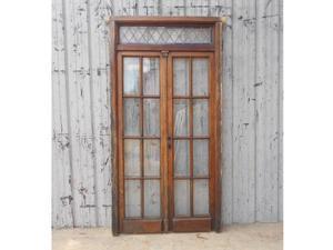 Antigua puerta de madera en cedro con marco (114x220cm)