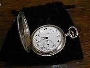reloj escasany de plata funcionando