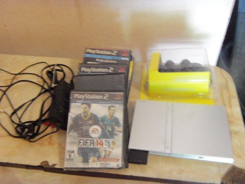 PLAY 2, PS2, con 1 joystick nuevo, memoria y 10 juegos, como