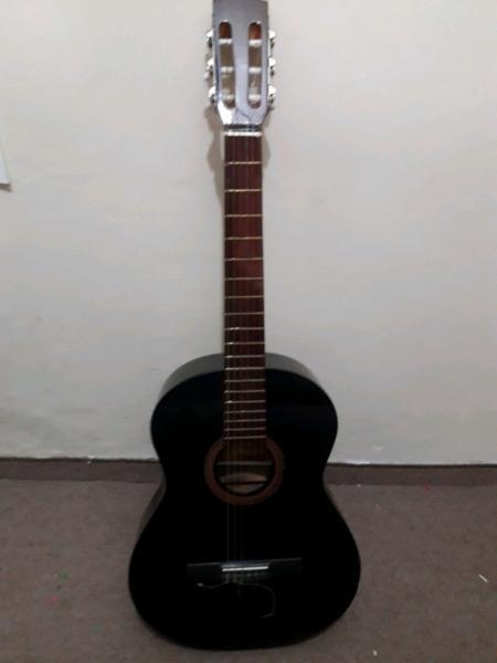 Guitarra criolla con funda y pie