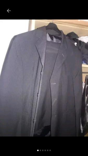 traje ambo pantalon y saco negro
