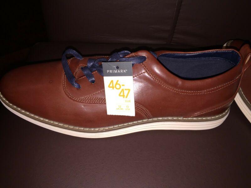 Zapatos de cuero marrón nuevos