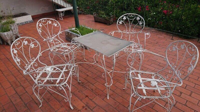Antigua mesa y sillas de jardín estilo colonial 4 sillas