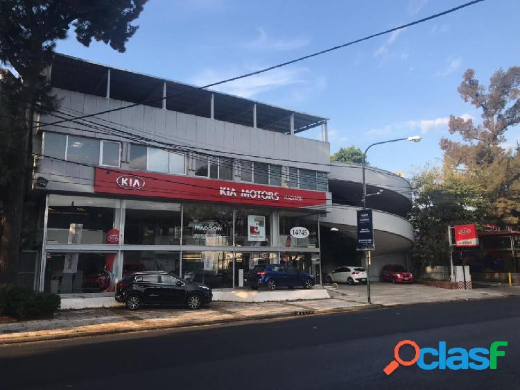 SALON DE EXPOSICION, COCHERAS Y OFICINAS