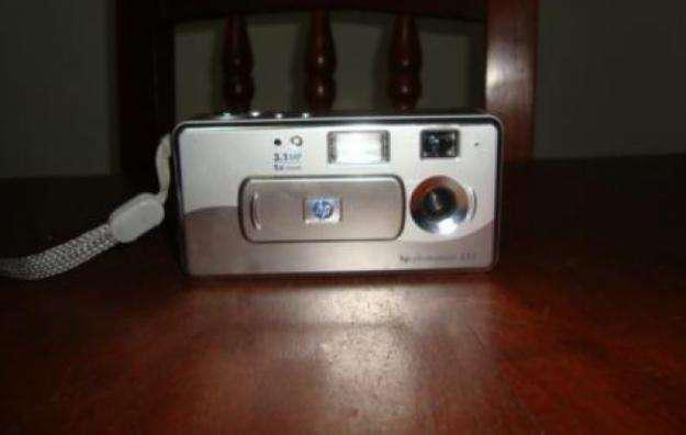 Camara hp photosmart usada 3.1 mp cargador de pilas