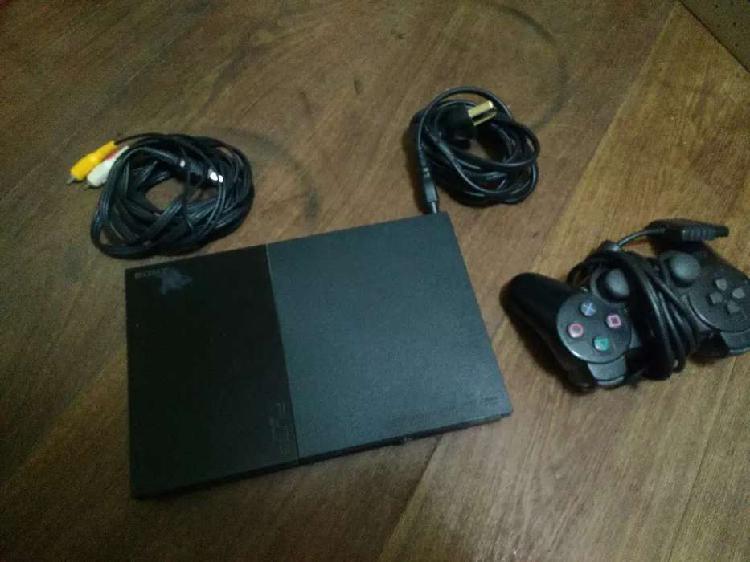 PS2 con joystick y volante con pedales y 19 juegos
